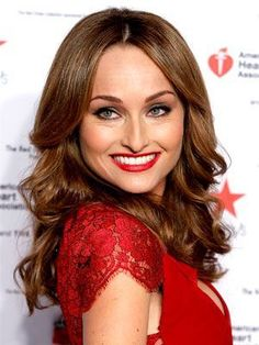 Giada De Laurentiis middle-parted soft waves with romantic red lipstick | allure.com