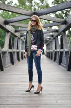 picture of contrasts- the lady-like, chanel-esque tweed jacket over a vintage tee and jeans.