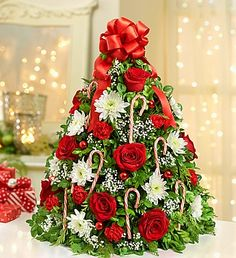 This fresh floral twist on a traditional tree makes a great gift for family & friends and it just might become your new favorite part of the holiday decor! #christmasflowers #holidaygifts #christmasdecor