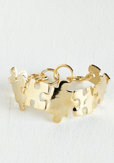 Love You to Pieces Bracelet. Theres nothing puzzling about why you love this gold bracelet - except for the jigsaw-shaped charms, of course! #gold #modcloth