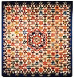 [Picture of the quilt: Star of Constantine]