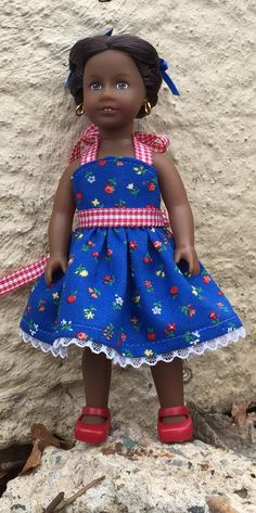This sundress is made of tiny floral patterned woven cotton with gingham ribbon trim. It wraps in the back with Velcro for easy dressing, then ties at the neck and waist. The bodice is lined. I made this tiny dress in my smoke-free home. Exposed seams have been zigzagged for durability.