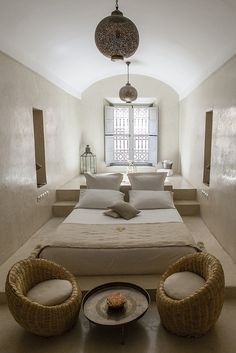 A neutral Moroccan bedroom. I made similar lighting fixtures for a client in Arizona last summer. Lovely decor. www.mycraftwork.com