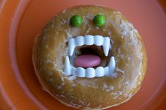 Bagel or Doughnut Face!! Fun Moster party food idea or Halloween breakfast or party treat! Doughnuts or use a bagel,  plastic teeth, gummy treat (tongue) and m & m (eyes)!