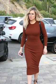 06e4cf96b0 Khloe Kardashian showed off her pert bum in a sexy skintight burnt orange  dress.