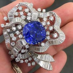 Fine Sapphire and Diamond Brooch, set with a 41.50 carats of cushion-shaped untreated Ceylon Sapphire.