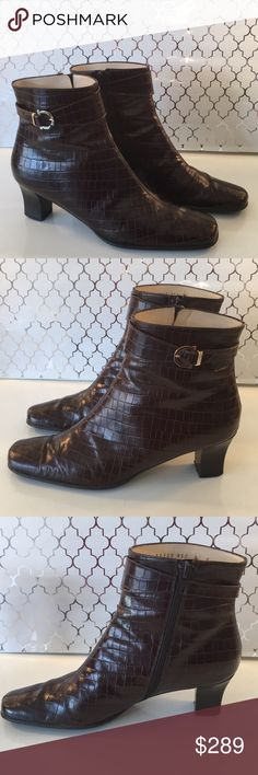 ⭐️SALVATORE FERRAGAMO ZIP BOOTIES 💯AUTHENTIC ⭐️SALVATORE FERRAGAMO ZIP BOOTIES 💯AUTHENTIC. STUNNING AND STYLISH TOTALLY ON TREND! TRUE SUPER HIGH END LUXURY AND STYLE! THEY ARE BROWN CROC IMPRINTED LEATHER WITH GOLD LOHO BUCKLE. RHE HAVE A SIDE ZIPPER. THE HEEL HEIGHT IS 2.25 INCHES. THE SIZE IS 8 . SO PRETTY! FEW MINOR SMUDGES. SUCH AMAZING AND BEAUTIFUL BOOTS! Salvatore Ferragamo Shoes Ankle Boots & Booties
