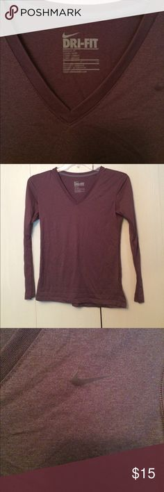 Nike dry fit longsleeve shirt size small P This is a Nike dry fit longsleeve shirt and a V-neck style in like new condition. Size small P. Always happy to consider offers on any of my items or bundles from my closet!  How do you tell from the pictures but this is kind of a light burgundy-ish color shirt Nike Tops