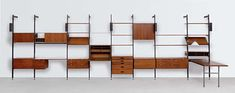 Comprehensive Storage System modualr shelving designed by George Nelson Associates and first manufactured by Herman Miller in George Nelson, Bookcase Shelves, Display Shelves, Unique Bookshelves, Wall Shelving, Bookcases, Mid Century Modern Design, Mid Century Modern Furniture, Basement Inspiration