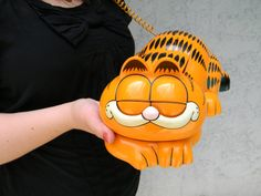 i so owned this phone as a kid. LOVED IT!     > Vintage 70s/80s ORANGE/BLACK Touch Tone GARFIELD Telephone - Working Collectible Phone 1978/1981