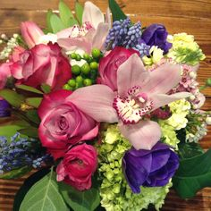 Love the colors in this arrangement. Such a fun and modern twist on the traditional Valentine's Day arrangement   www.amaranthusonmain.com