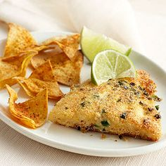 Cornmeal, bread crumbs, Parmesan cheese and herbs make the crispy coating for the fried fish in this Southern dinner recipe.