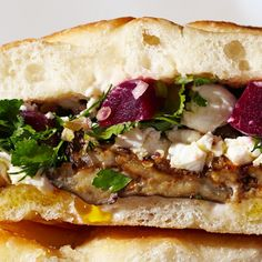 Meatless doesn't mean dainty. When making a veggie-centric sandwich like this roasted eggplant recipe, load up on aggressive flavors and contrasting textures, and be sure to add something substantial to sink your teeth into.