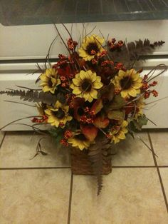Basket wall hanging flower arrangement.  Primitive/country setting