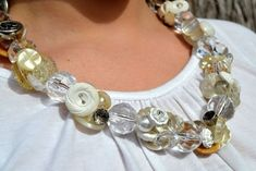 Fabric Flowers Jewelry, Button Jewelry Projects, and More | AllFreeJewelryMaking.com #jewelryideas