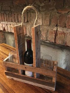 This item is hand made from recycled wood pallets - a great wine bottle and glass carrier or display item. This item can hold one bottle of wine and 2 glasses or 3 bottles of wine. A simple, rustic design with a natural rope handle. Dimensions - 15 wide by 5 deep by 15 high. A great item to display on your bar or dining room table. Makes a great gift for the wine lover in your life.