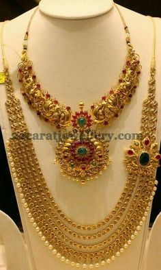 Antique finish gold peacock designer short necklace with simple pota rubies and emeralds all over. Two step designer pendant attached in . Traditional Indian Jewellery, Indian Jewellery Design, Jewelry Design, Indian Wedding Jewelry, Bridal Jewelry, Gold Jewelry, Bridal Necklace, Indian Bridal, Necklace Set