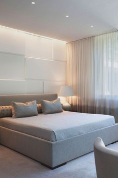soft lighting and pale contemporary neutrals for the bedroom (fabulous wall of sheer curtains)