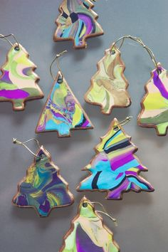 Sue - good way to use scraps by marbling and then use a gold leaf pen on the edge of any shape ornament.