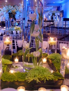 """The client told me, """"We want the party to be relaxing and fun, the flowers are very simple and modern. We'd like a strong look in green and white. We also love candles. And we'd love to give away f…"""