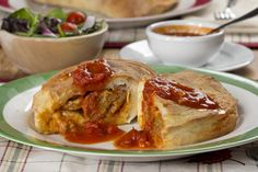 Whether it's game day or just a busy day, our Meatball Calzones are a great choice for both. They're quick to put together, quick to bake, and even quicker to gobble up. And since we like to overstuff our calzones, you can bet everyone will feel full Meat Recipes, Appetizer Recipes, Cooking Recipes, Dinner Recipes, 30 Minute Meals, Quick Meals, Cheese Stuffed Meatballs, Pizza Snacks, Hamburgers