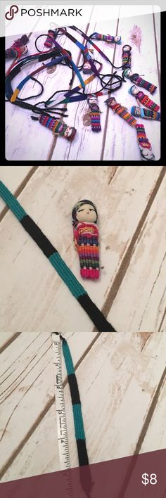"""Teal & Black friendship bracelet + Guatemala doll Handmade bracelet from Antigua, Guatemala - end to end length is 12"""" - bracelet weave is 5.5"""" of that. ***Comes with a Guatemalan worry doll made of fabric scraps. The indigenous people of the Guatemalan Highland made them as a remedy for worrying. Mayan legend says when worrying keeps you awake, tell the worry to as many dolls as necessary, place dolls under pillow & they take on worrying so you sleep peacefully till morning.  **all proceeds…"""
