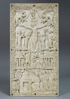 Plaque with the Crucifixion, Carolingian ivory, France, c. 870. Metropolitan Museu of Art, NY. It depicts an allegorical crucifixion, a common theme in Metz ivories. Above the cross are bust-length personifications of the sun and the moon. From Christ's right side flows a stream of blood and water, which is caught by a personification of the Church. To the immediate right of Christ is the hooded figure of Synagogue, her body turning away.