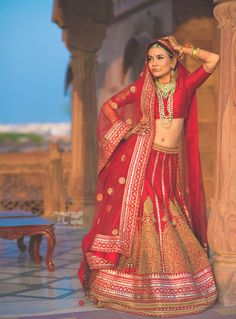 Bridal Lehengas - Red Bridal Lehenga with Gold Scattered Motifs and Gold Zari Work | WedMeGood #wedmegood #bridal #lehengas