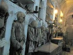 "Capuchin Catacombs, Sicily.  Beneath the streets behold a ""human library"" of 8,000 embalmed bodies dressed in their funereal finest. Spanning 5 centuries."