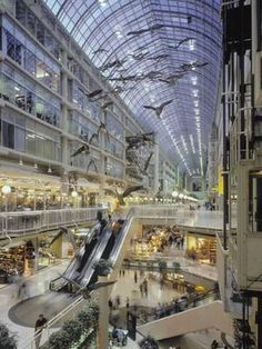 Toronto Eaton Centre - loved the glass ceiling.  There are shops on the lower levels and office space on the upper levels.  Shopping and working under the same roof - nice!!