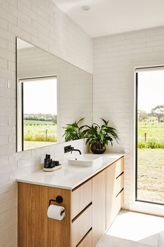Surrounded by the rolling hills of Barrabool is Eve and James Coates' modern farmhouse — a custom-built Hamlan home for a couple who love the outdoors. Double Vanity, Custom Homes, Modern Farmhouse, Eve, Bathrooms, Outdoors, Couple, Building, Outdoor