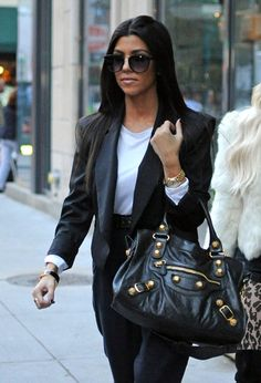 Kourtney showed off her leather City bag while hitting the streets of NYC, with sister Kim.   Brand: Balenciaga