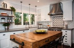 This transitional kitchen by KK Design Koncepts incorporates industrial and…