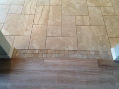 Image result for using decorative tile to transition between ceramic tile.and wood.floor