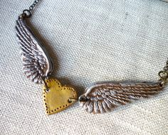 Winged Heart in Silver and Gold  Clay necklace by Palomaria, $36.00
