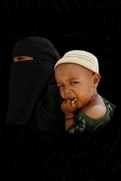 Veiled woman and baby - Yemen by Eric Lafforgue