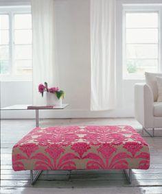 Pink damask velvet & modern ottoman in a white living room