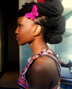 3 Bantu Knots Updo with yarn twists. Really love the butterfly in her hair.