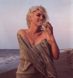 ...Marilyn Monroe Sipping Wine On The Beach...
