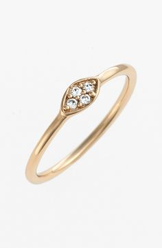 The sparkling setting on this delicate 14-karat gold ring adds the perfect amount of bling.