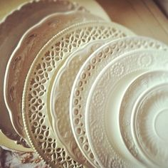 mis-matched ivory plates collected from Charity shop/jumble/yard sales, for the wedding breakfast