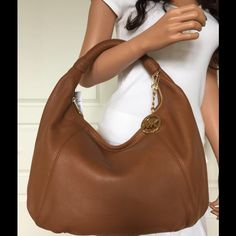"""Michael Kors Leather Hobo Bag NWT  Michael Kors High Quality Brown(Luggage) Colored Leather Shoulder Hobo Tote Bag Purse 100% AUTHENTIC MICHAEL KORS BAG  With DUST BAG EXTERIOR: LEATHER SHOULDER STRAPS 10"""" DROPS POLISHED GOLD TONED NICKEL HARDWARE ZIPPER  TOP CLOSURE ONE MICHAEL KORS GOLD CIRCLE CHARM HANDTAG  INTERIOR: STAIN AND WATER RESISTANT MK SIGNATURE FABRIC LINING FOUR SLIP IN MULTIFUNCTION  POCKETS ONE ZIPPER POCKET APPROXIMATE MEASUREMENT: 15""""(L)  X 12""""(H)  X 6"""" (D) VERY CLEAN…"""