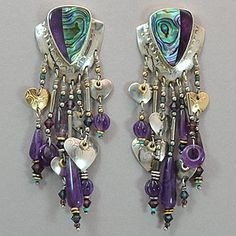 """Tabra Vintage Abalone Shell and Amethyst Post Earrings. Abalone shell and amethyst inlay, set in sterling silver. Decorated with beads and embossed shapes, including beads of amethyst, crystal, turquoise, gold fill, and sterling silver. Measures 3"""" long by 1"""" wide."""