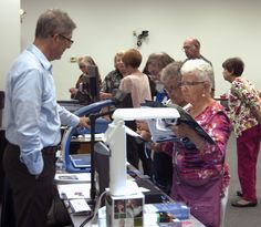 Attendees explored adaptive technologies at the Cleveland Sight Center tables.