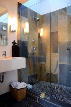 Beautiful Chic Bathroom & gorgeous shower with slate tiles used in a color blocking style.