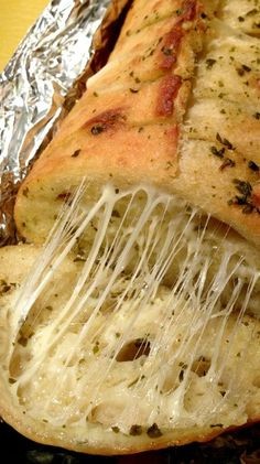 Irresistible Cheesy Pesto Bread ~ This ooey, gooey, cheesy garlic bread is simple to make with only four ingredients.