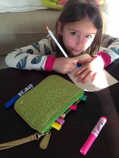 Our pouches are great for kids too!  Erela keeps her markers inside the Mumbai Lime Medium Flat Pouch.