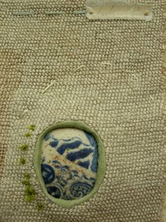 """Part of the River Wall series by textile artist Hannah Lamb, the work inspired by walks along a local river. I was drawn to her use of a found piece of china to """"patch"""" her work. She later also work on the visible mending and darning theme."""