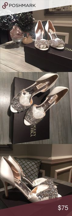 Badgley Mishka white satin shoes Beautiful never worn Badgley Mishka peep toe white satin shoes. Bought them as an extra pair for my wedding. Gorgeous jewel detail!! Badgley Mischka Shoes Heels