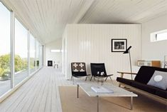 The same material used as interior cladding everywhere!  Summer home of Henrik Nygren and Susanna Nygren Barrett, on Gotland, the Swedish island, overlooking the sea.  From Skona Home